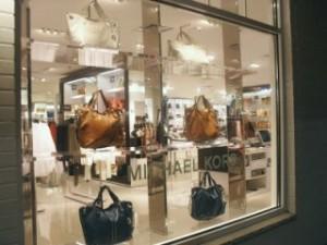Woodbury Commons Store Window showing Michael Kors handbags